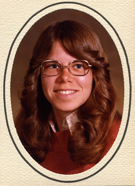 retro feathered hair and glasses from the 70s: graduation picture