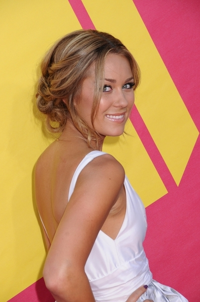 Lauren Conrad with loose weave updo