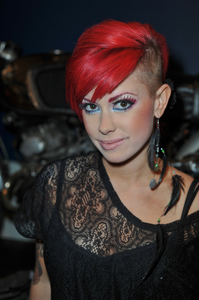Hairstyle Half Shaved : Side swept bangs brush across the forehead. The color is bright red ...