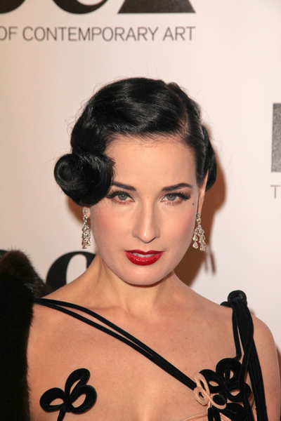 This updo has vintage appeal with a section that is twisted up to resemble a
