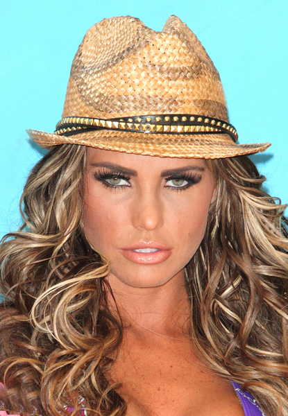 Katie price long curls and fedora