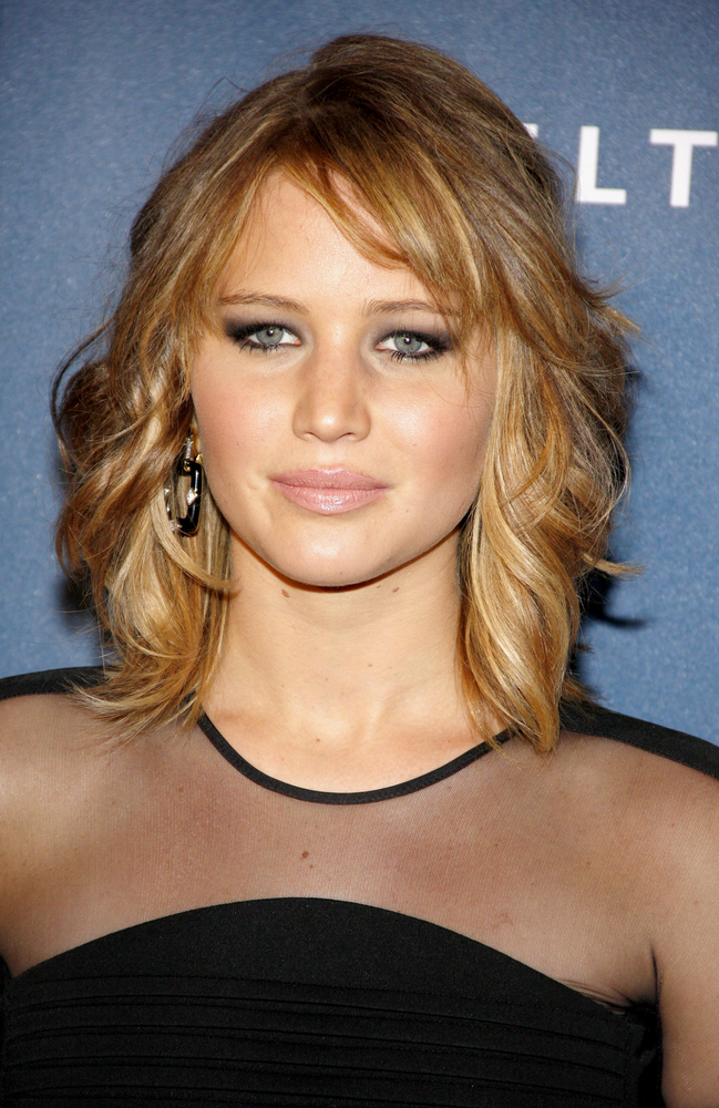 Jennifer has a medium length layered hairstyle that is shoulder length ...